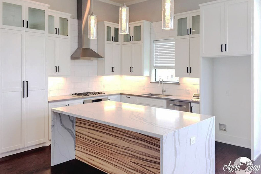 kitchen island in white marble serving as dining bar