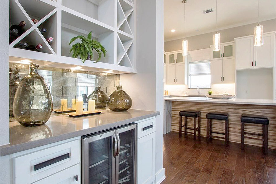 view of kitchen island with bar stools from dining