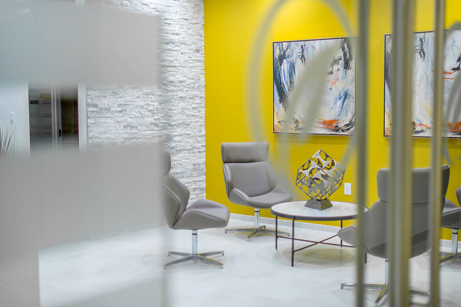 Office lobby with modern decor and yellow wall