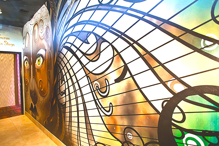 detail of a mural inside a theatre building lobby