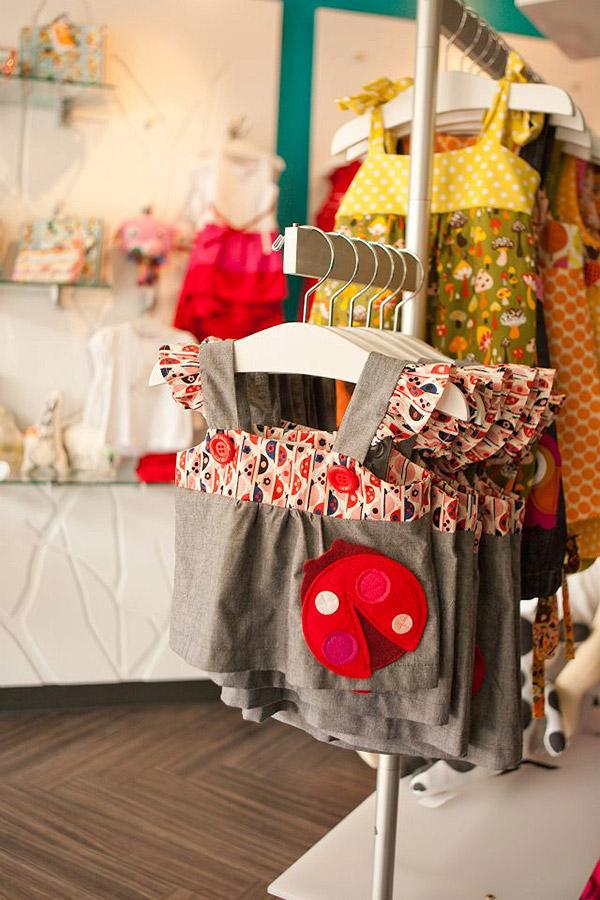 Clothing rack at the children's store Liz & Kirby designed by Shundra Harris Interiors