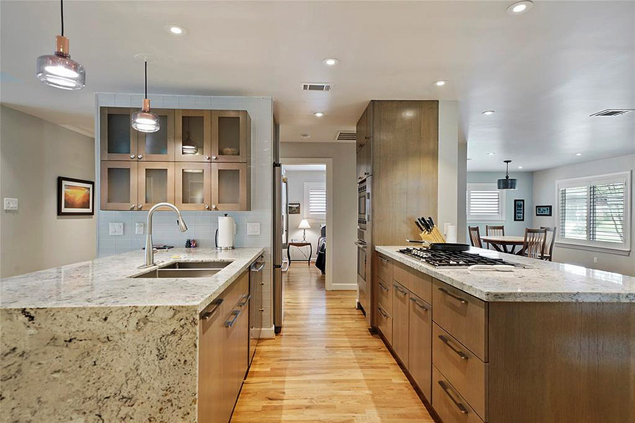contemporary kitchen with glass front cabinets