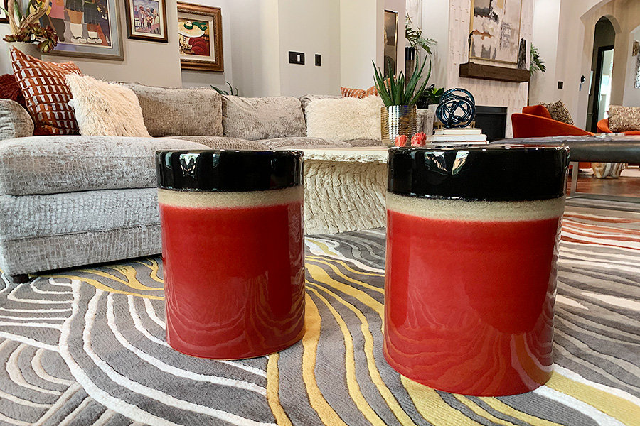 cozy living room with rich colored ceramic tables in shiny black and red lacquer