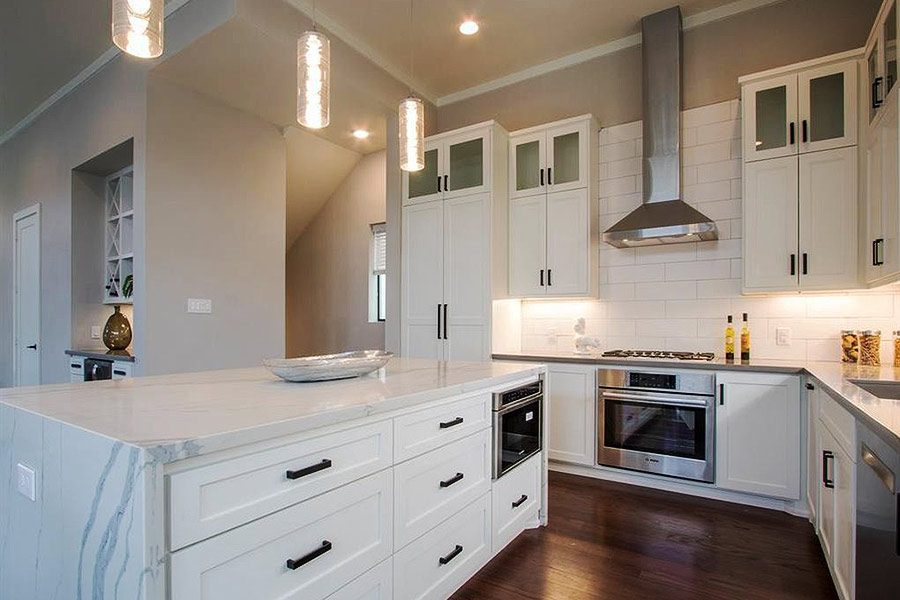 White marble Kitchen Island with drawers and built in microwave