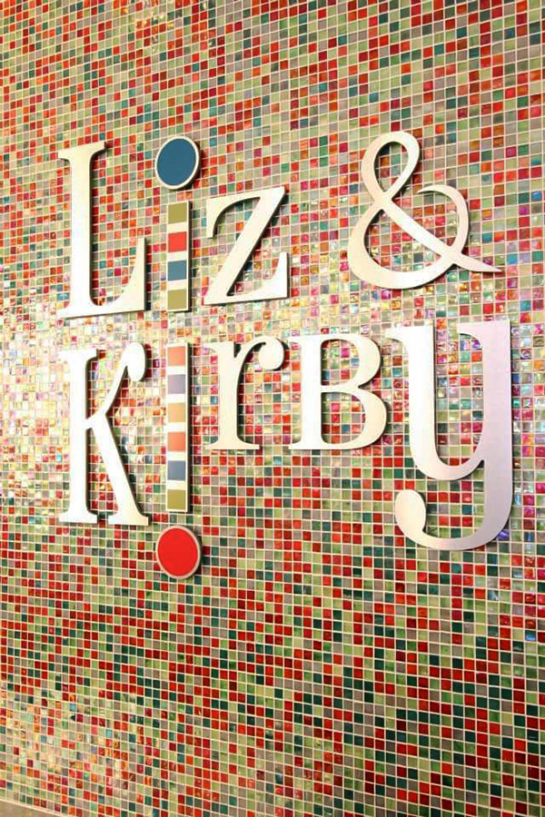 Commercial sign with words Liz & Kirby of a children's clothing store designed by Shundra Harris Interiors