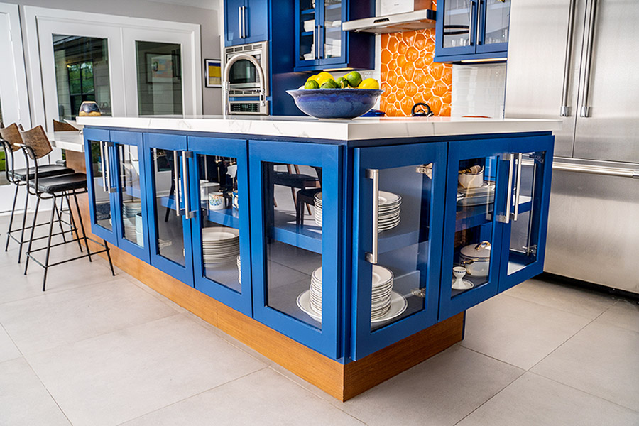 kitchen island with built in cabinets painted in blue around the frames.