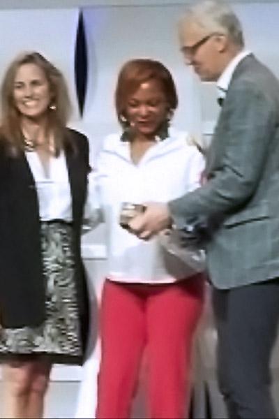 Shundra Harris receiving an award