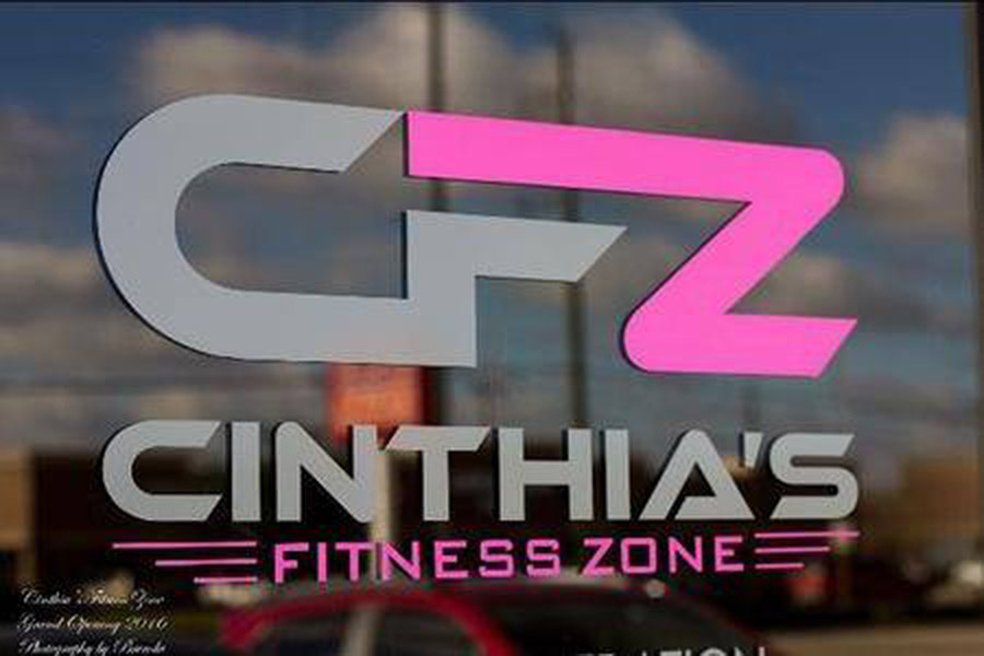 Signage on the store front of Cinthia's Fitness Studio designed by Shundra Harris Interiors
