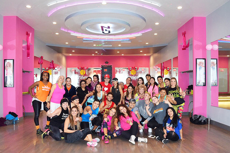 Group photo of fitness clients and trainers at Cinthia's Fitness studio designed by Shundra Harris