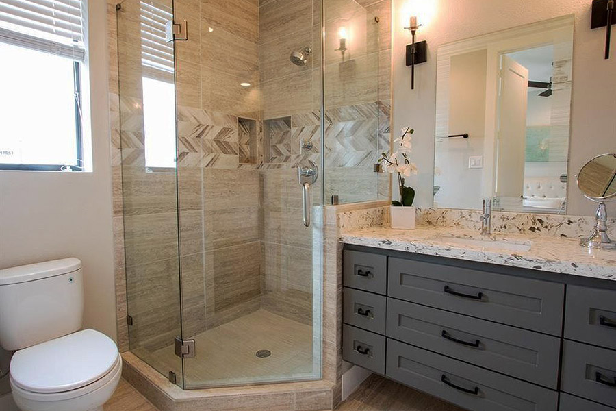 bathroom with glass enclosure stand up shower and marble top vanity with shaker style drawers