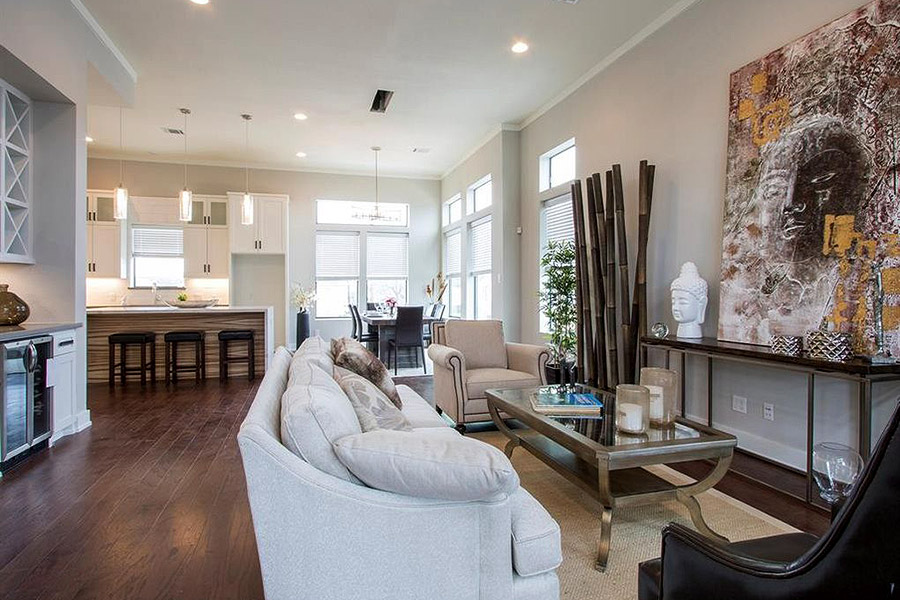 living room with white sofa and a glass top coffee table with iron frame