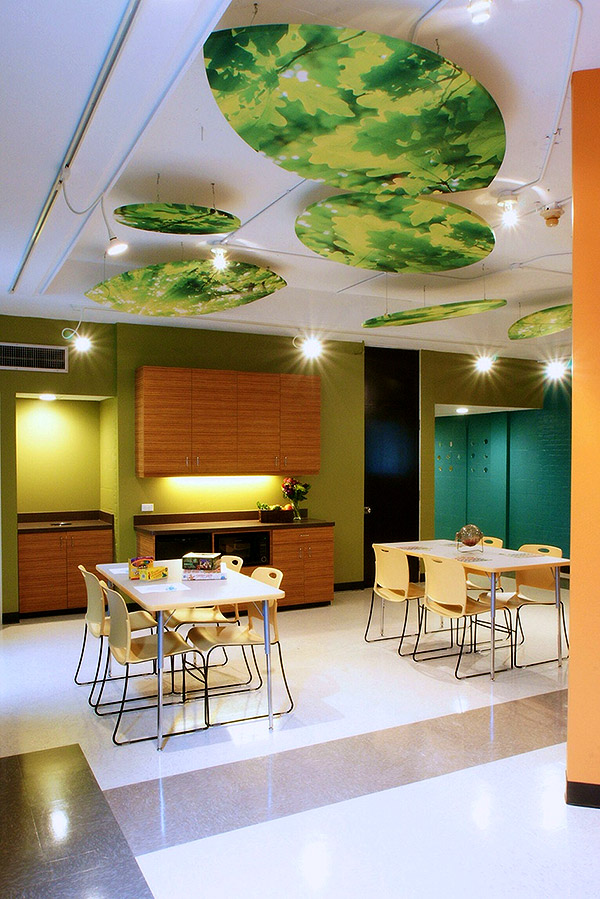 cafe area in a commercial space with ambient lighting and foliage looking ceiling lights