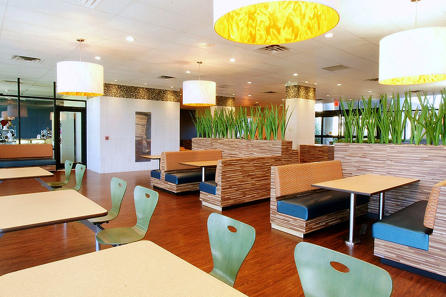 Turquoise dining chairs in the cafeteria of a rehab center