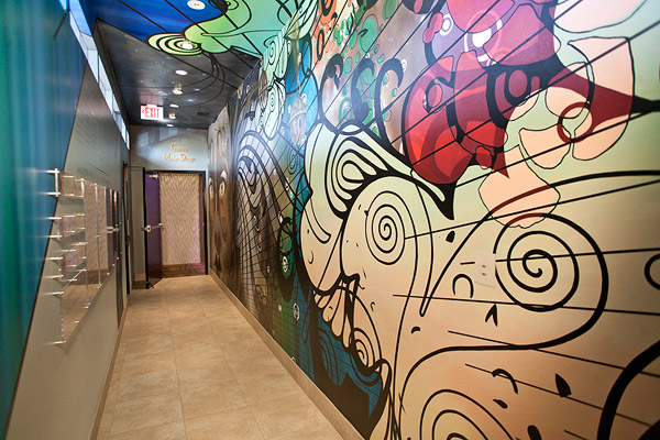 Entrance lobby of a theatre with a bold and colorful wall mural
