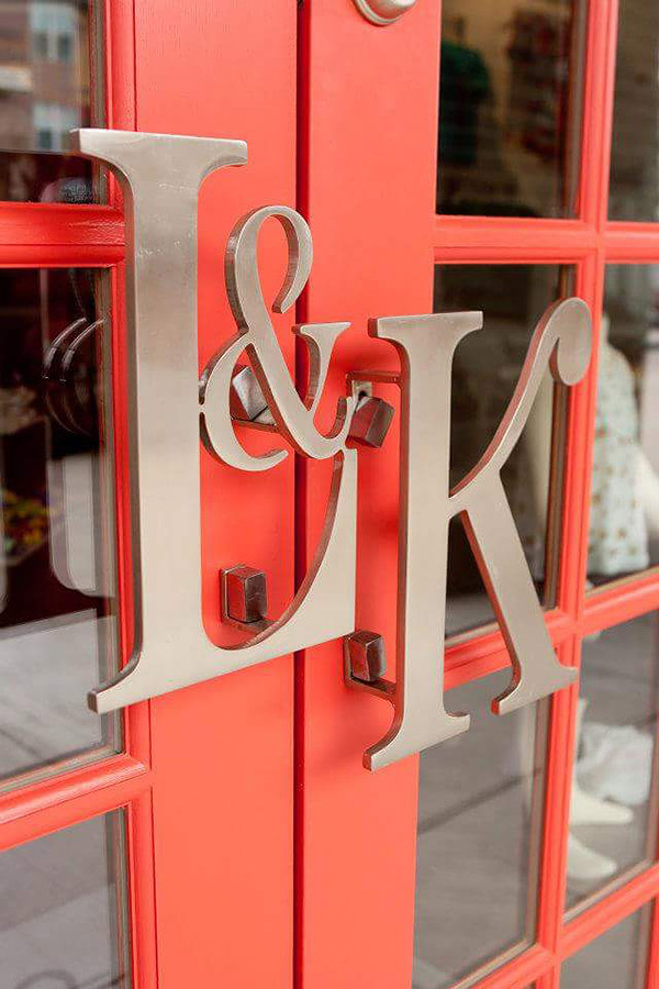 Signage designed for store front door as initials of the business L & K for Liz & Kirby, by Shundra Harris