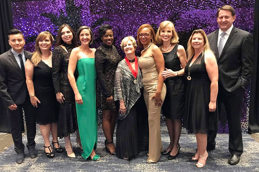 Shundra Harris with ASID TXGC board members at an formal event