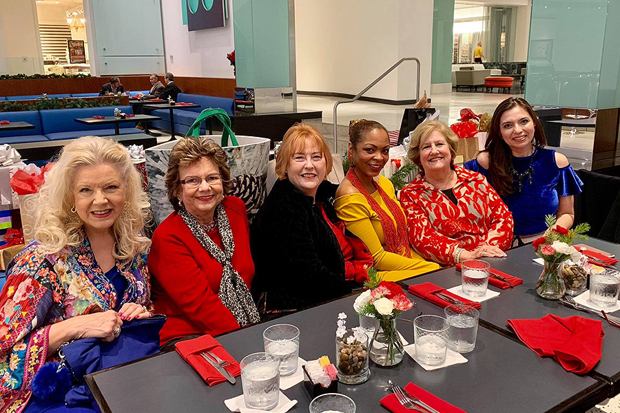 Shundra Harris sitting at a long table with past presidents of ASID