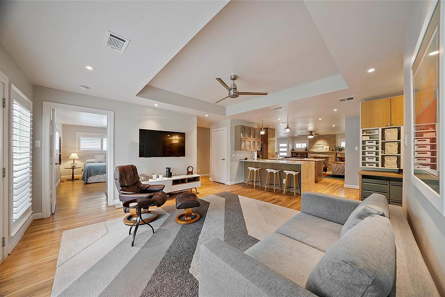 Spacious living room with high ceilings and mid century flair