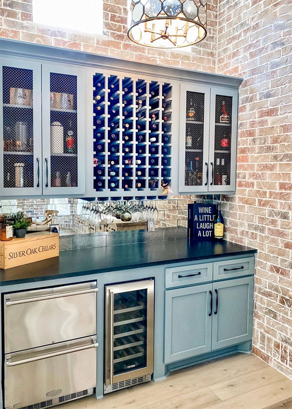 butlers pantry with antique aqua cabinets and wine rack