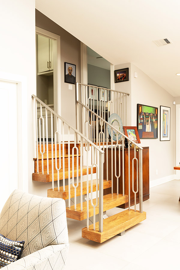 short staircase leading 5 steps up from the living room to the rest of the rooms and hallways